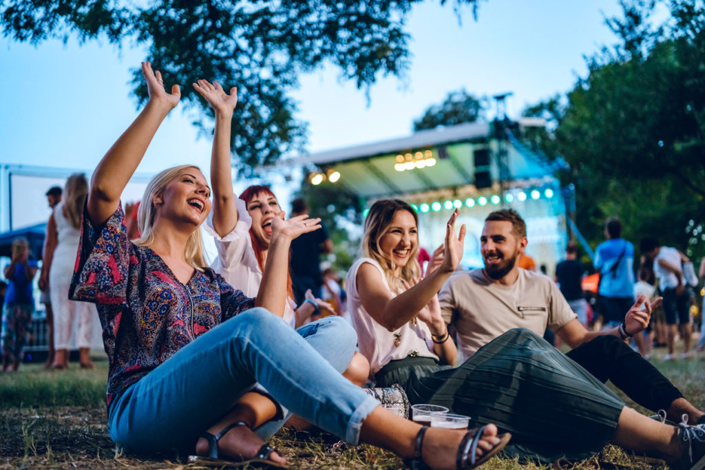 group of friends listening to music at a concert together